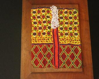 ANTIQUE TRIBAL TEXTILE on mahogany panel