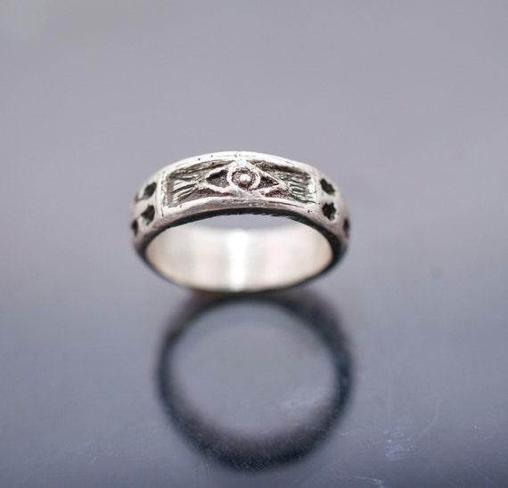 silver ring whit skulls snake cross and eye