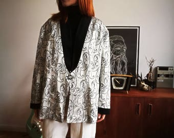 Festive oversize silver jacket with black collar