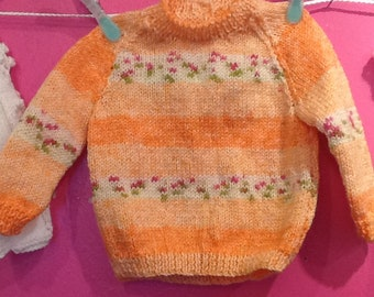 Hand knitted baby girl jumper