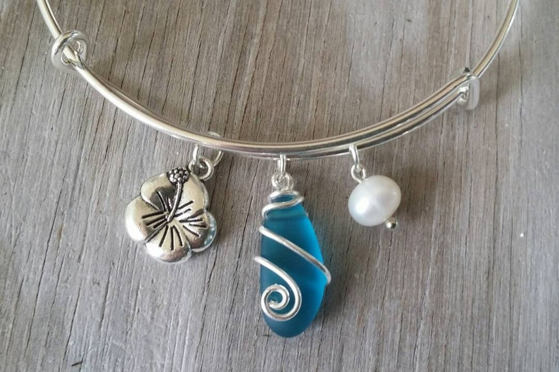 62ee3de14b289 Handmade in Hawaii, wire wrapped teal blue sea glass bracelet, Sea glass  jewelry,Hibiscus charm, Fresh water pearl, Hawaiian jewelry.