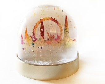 Snow Globe of London, Christmas decoration of water colour images of London, tower bridge, Big Ben, London Eye , the Shard, parliament