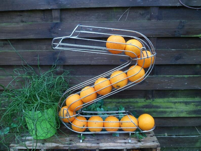 Distributor of fruit, oranges, vintage fruit basket basket