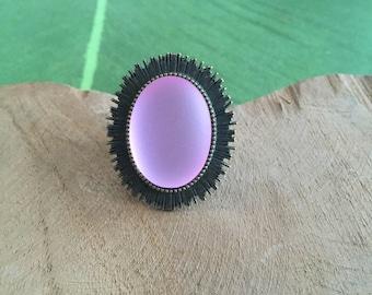 Fuchsia colored fancy ring