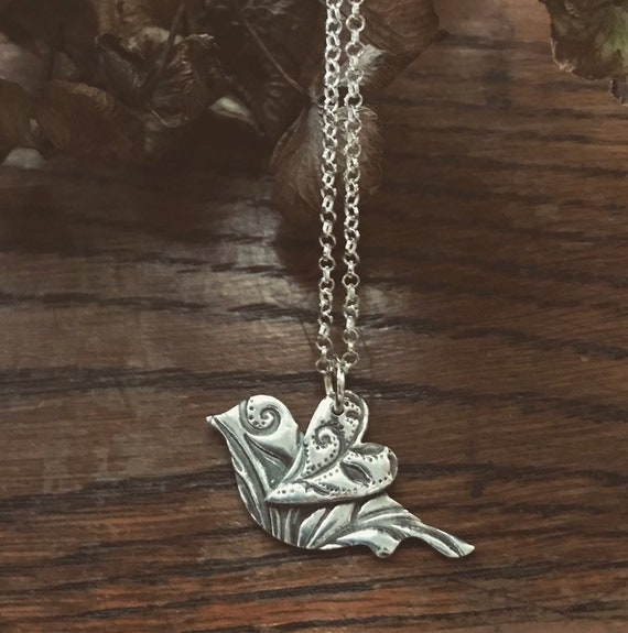 A beautiful Handmade from Fine and sterling Silver bird necklace, loveheart wing bird, silver bird necklace, bird jewellery