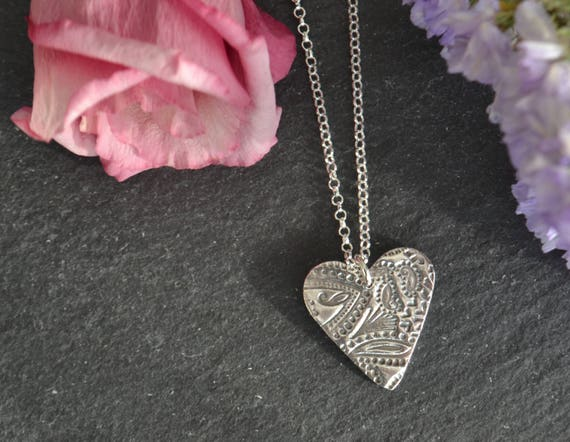 Handmade fine and sterling silver paisley heart necklace.