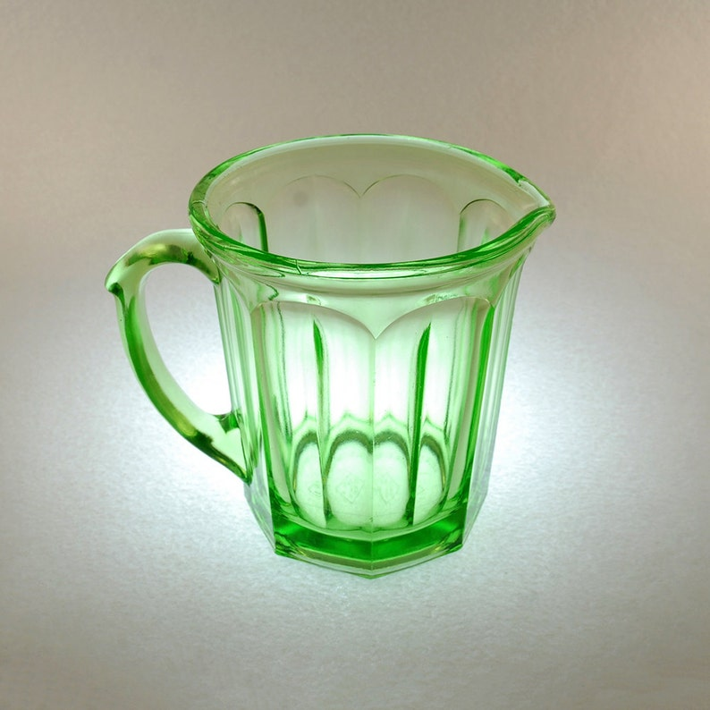 dcfff68dfdb A   J Paneled Green Uranium Glass Pitcher Arched Paneled