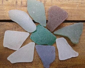 9 sea glass pieces 1.5''- 2''[3.8-5cm]. Genuine natural beach glass. Surf tumbled glass for various crafts and decoration.