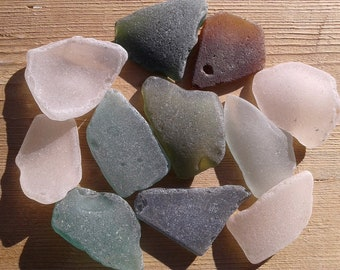 11 sea glass pieces 1.5''- 2''[3.8-5cm]. Genuine natural beach glass. Surf tumbled glass for various crafts and decoration.