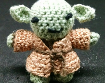 Tiny crocheted Star Wars Figure Yoda.  Less than 2 inches tall. Amigurumi.