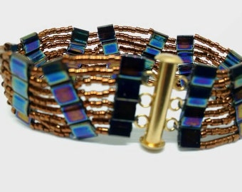 Beaded ladder bracelet. Copper lined seed beads and iris tile beads