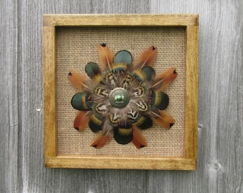 Feather wall hanging with natural hard wood frame.