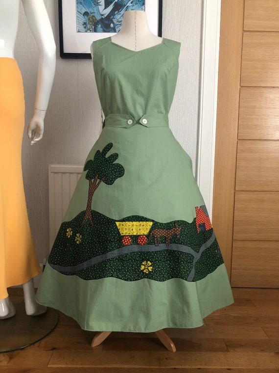 Deadstock 1950s novelty print wrap dress by Evelyn