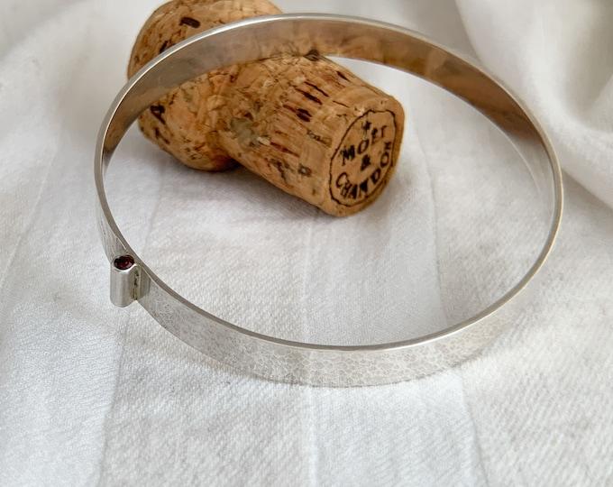 Silver and Garnet hammered bangle