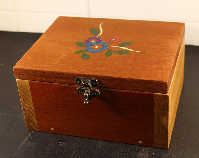 handcrafted mahogany and ash with inlaid flower top