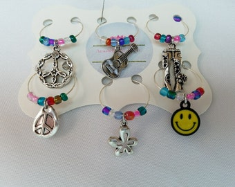 Hippie Days Wine Charms; Celebrate the Hippie in You; Peace;Guitar;Bell Bottoms; Peace Sign;Flower;Smiley Face; Wine Charms; The 70's