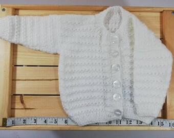 0d24258b4 White baby cardigan