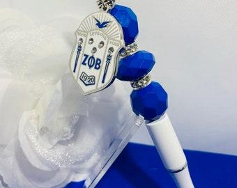 White with All Blue Beads Zeta Phi Beta Shield Pen