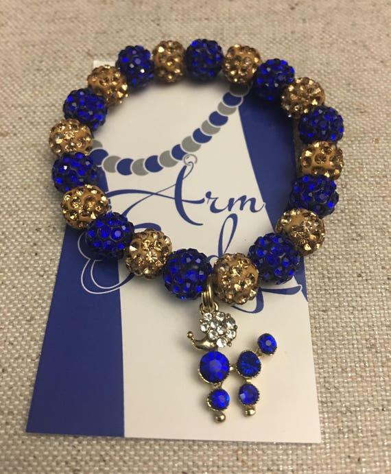 Blue and Gold Rhinestone Poodle Bracelet.