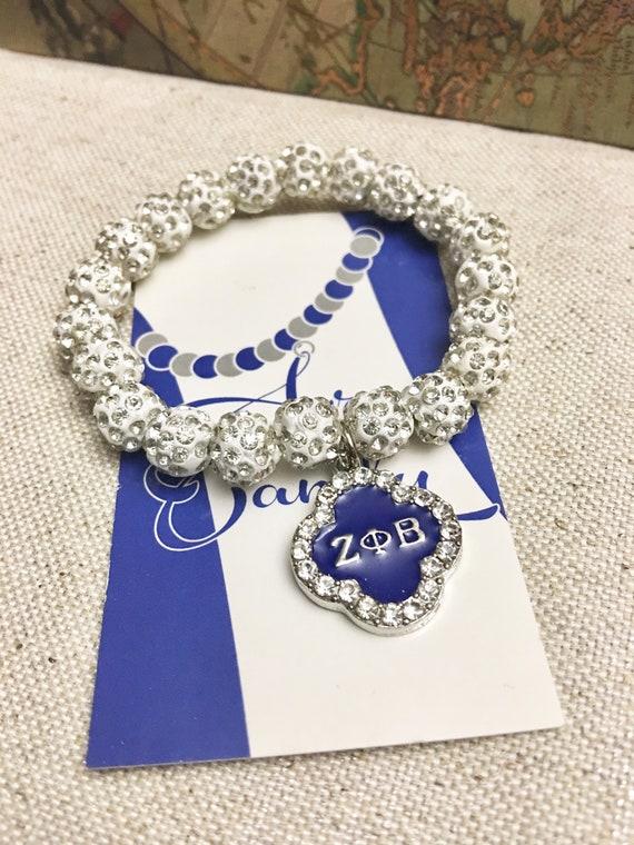 "White ""Sparkle"" Bracelet with Rhinestone Charm"