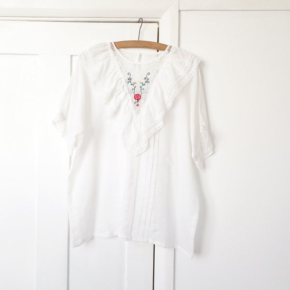 White Ruffle Blouse with Floral Embroidery . Large