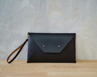 Dark brown leather clutch