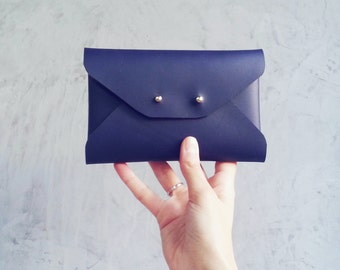 Navy blue leather mini clutch