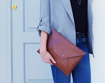 Brown leather clutch bag