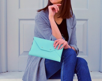 Turquoise leather clutch bag