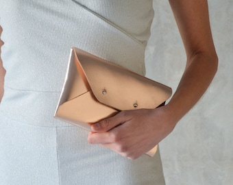 Rose gold leather clutch bag