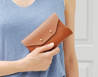 Brown leather mini clutch, available with a wristlet