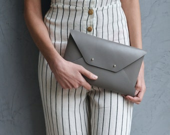 Gray leather clutch bag