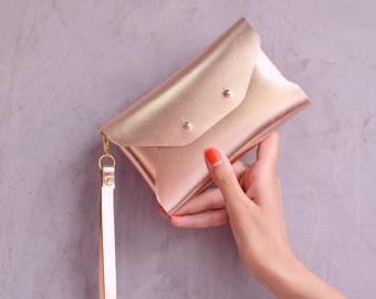 Rose gold leather mini clutch