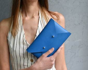 Blue leather clutch bag