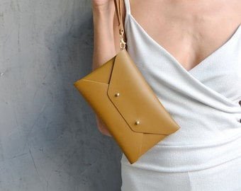 Brown mustard leather clutch bag
