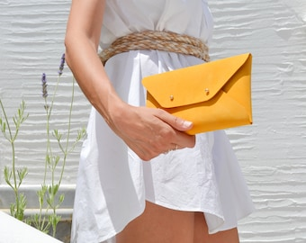 Mustard yellow leather clutch bag