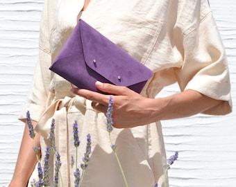 Dark purple leather clutch bag
