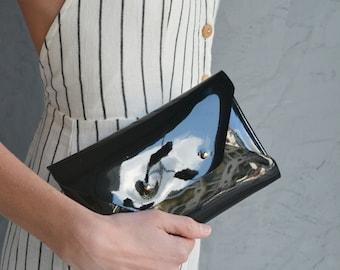 Patent black leather clutch bag