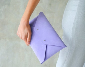 Purple leather clutch bag