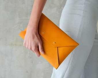 Ochre leather clutch bag, available with strap