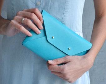 Deep aqua blue leather clutch bag