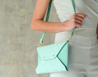 Aqua green leather clutch bag