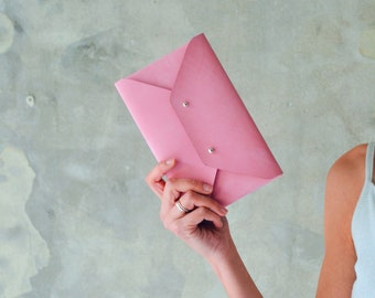 Hot pink leather clutch bag
