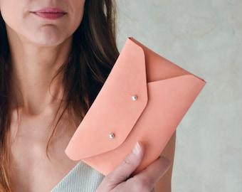 Peach leather mini clutch