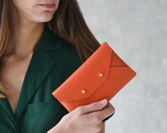 Burnt orange leather mini clutch