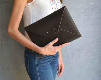 Dark brown leather clutch bag