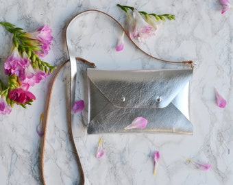 Silver leather clutch bag