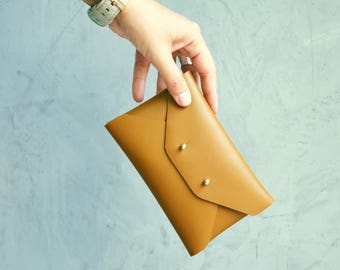 Brown mustard leather mini clutch