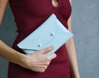 Light blue leather clutch bag