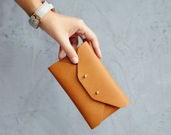 Gingerbread brown leather mini clutch